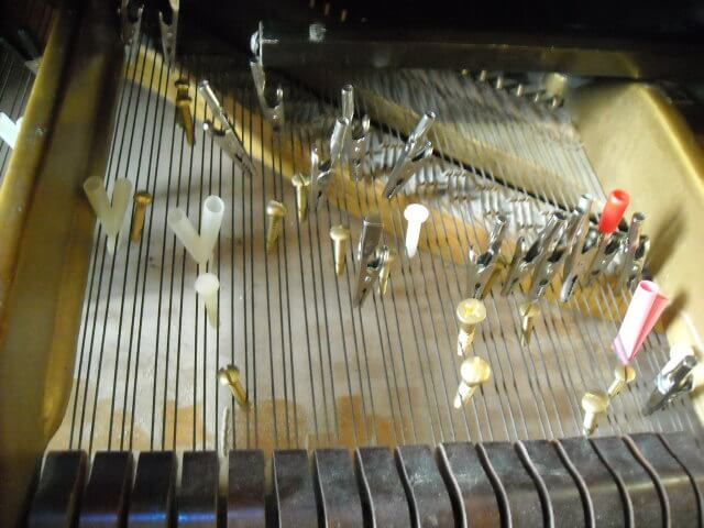 Prepared Piano, top of keyboard.